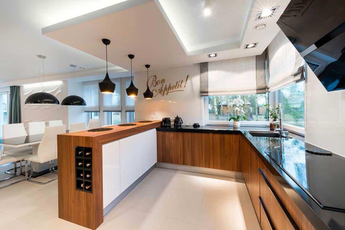 Modern kitchen interior design in a black and white themed luxury villa
