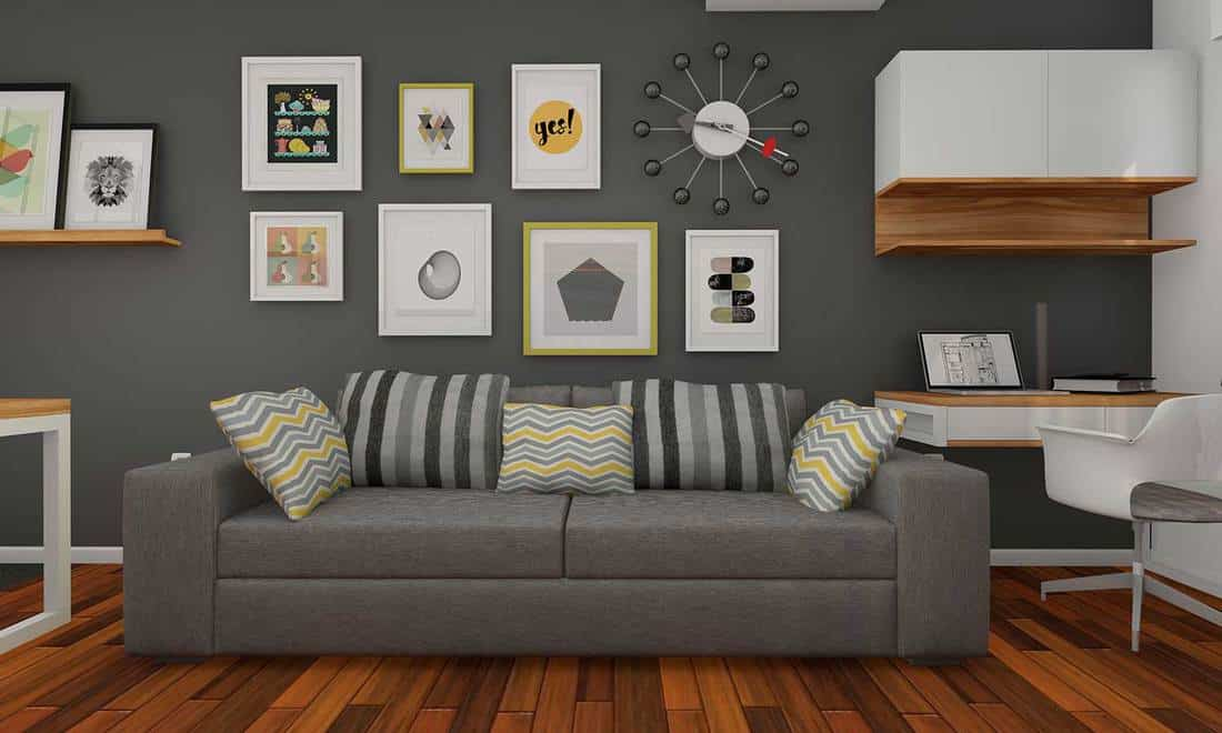 Modern living room with gray couch and small home office