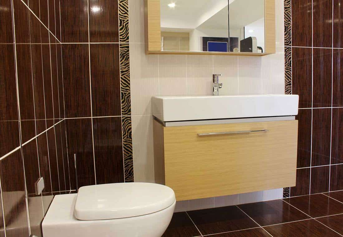 Modern restroom interior with toilet and sink