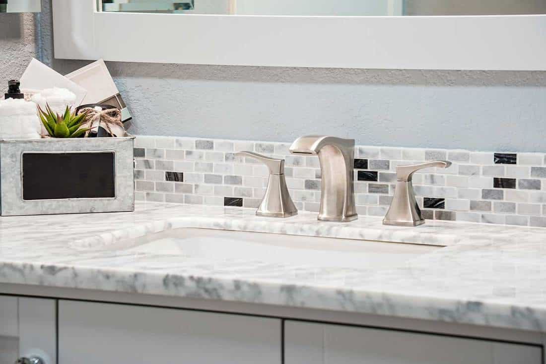 Modern sink, counter and faucet in a residential bathroom