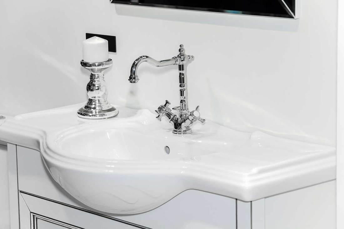 Modern white sink on white cabinet