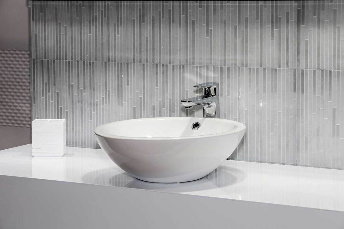 Modern white wash basin on white countertop
