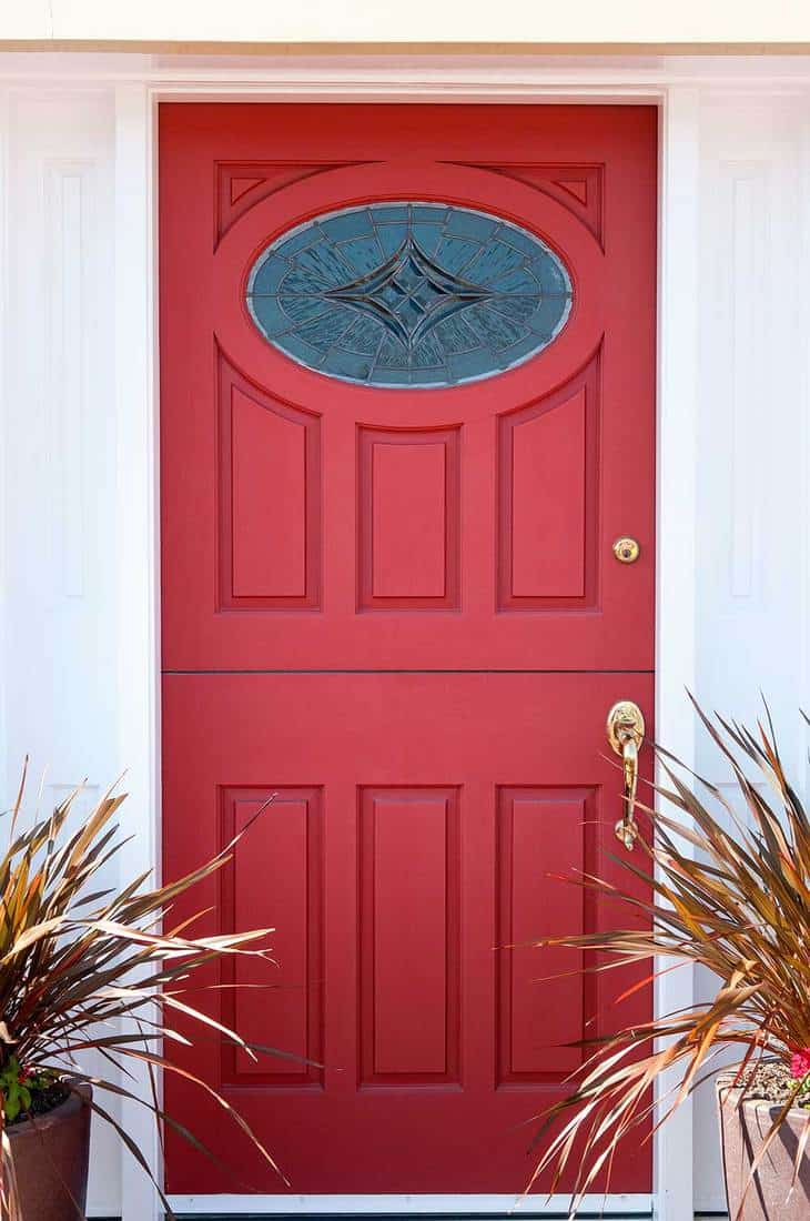 Red door with leaded glass on front entrance
