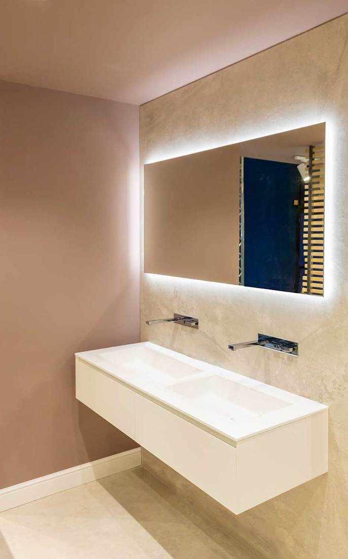 Scandinavian style restroom with large mirror above white double sink