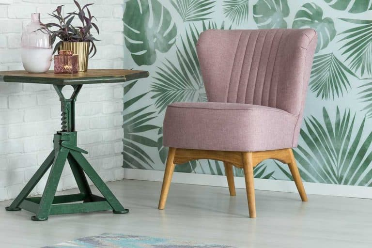 Modern living room with pink slipper chair beside coffee table