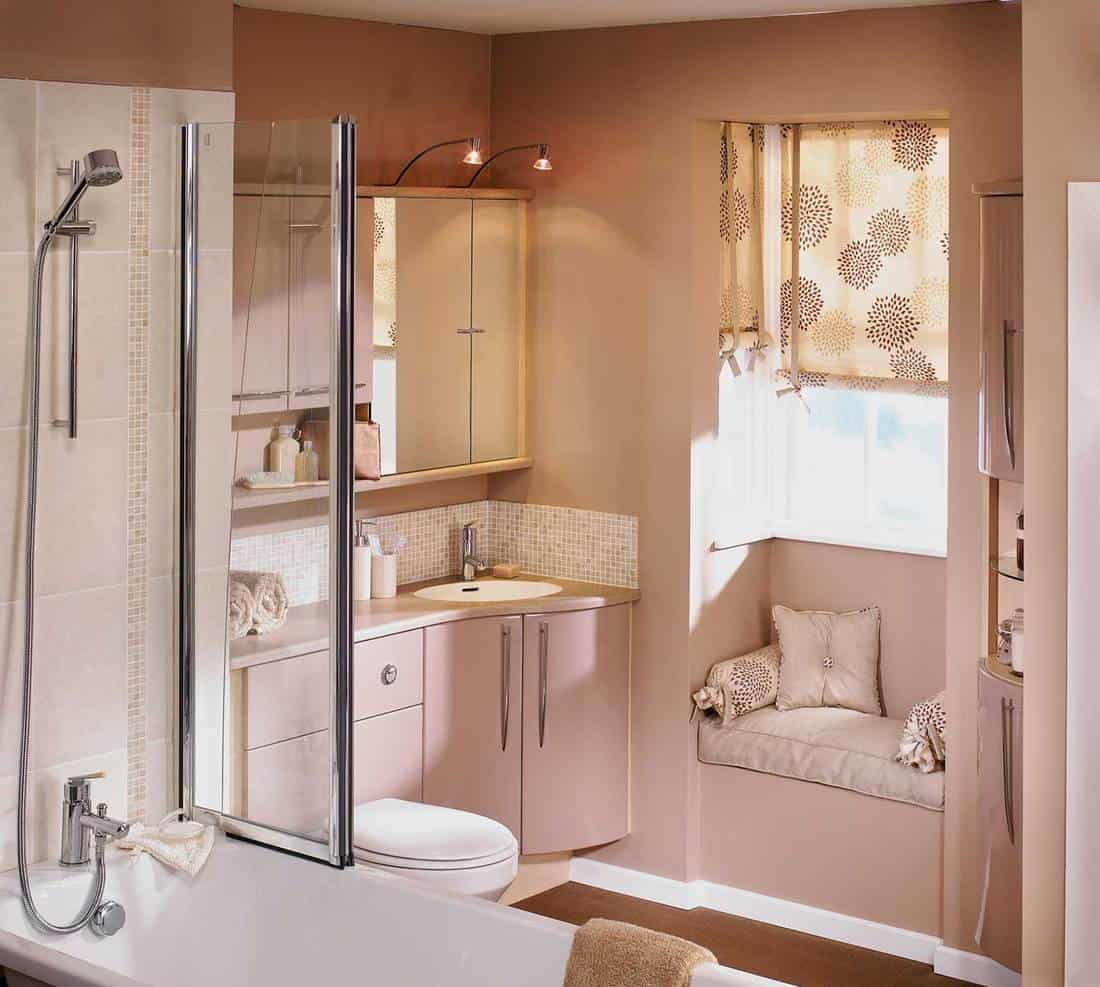 Small luxurious bathroom with cupboards, shower and sink