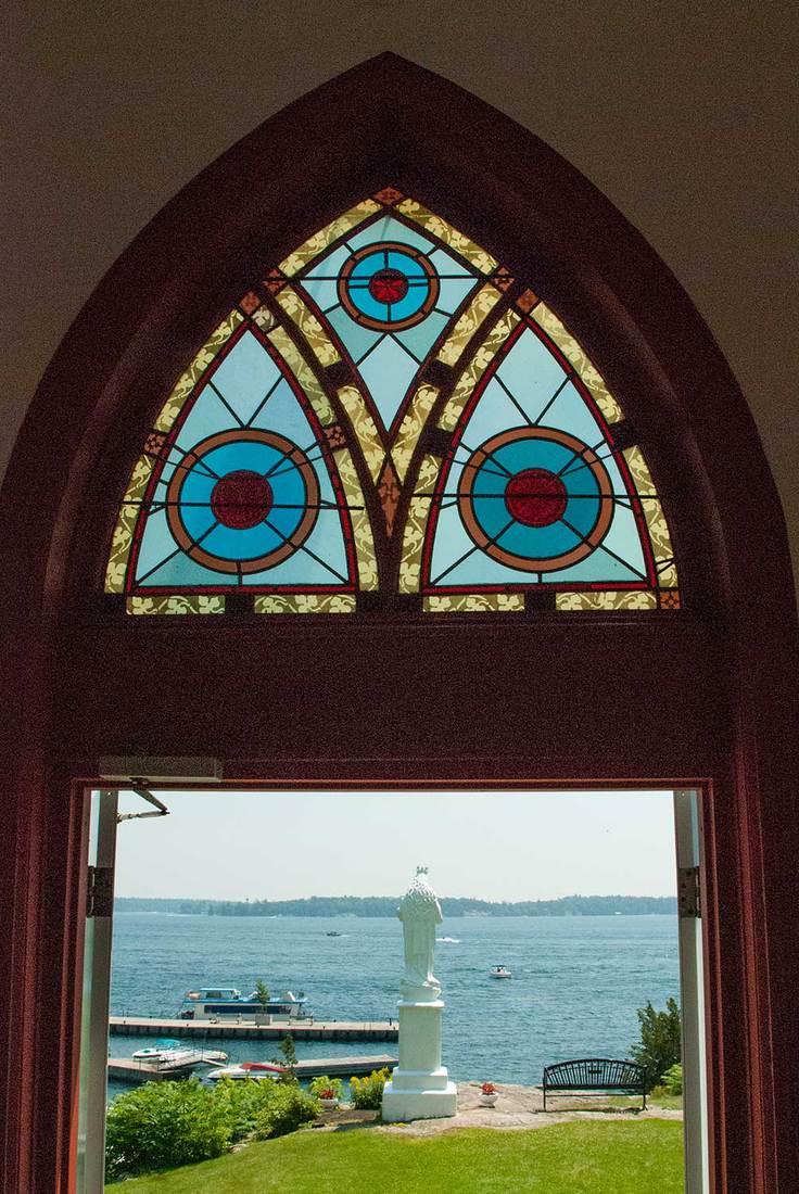 Stained glass window over doorway