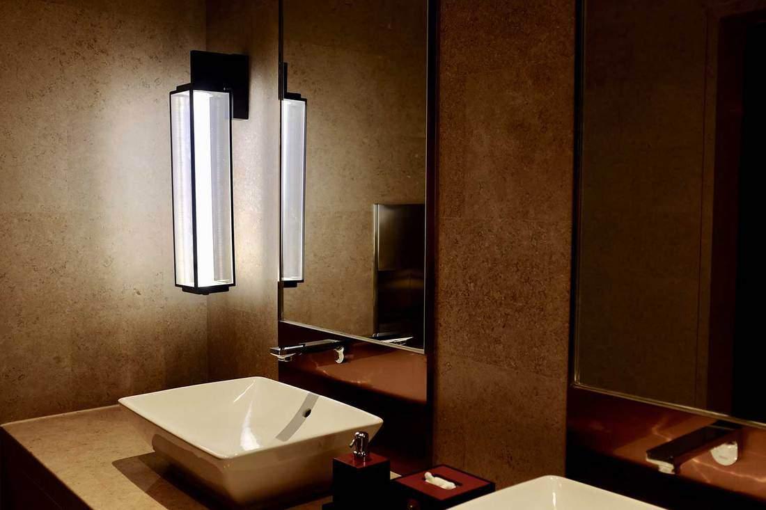 Stylish bathroom with two sinks and lighting