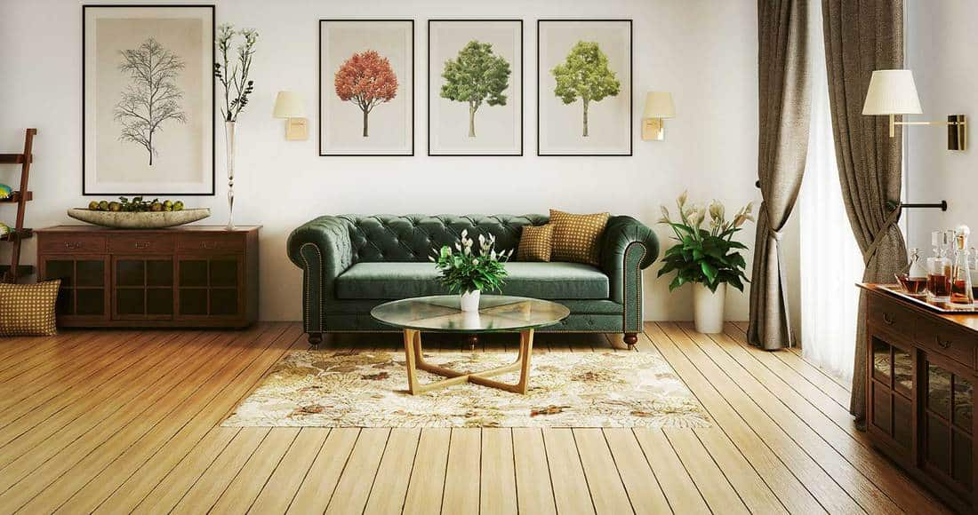Stylish home living room interior with wooden furniture, green sofa, top glass coffee table and hardwood floor