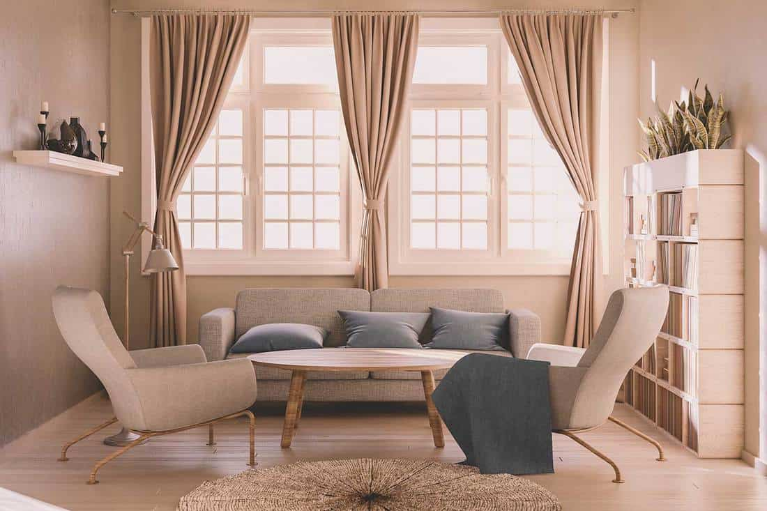 Sunlit modern living room with cozy sofa set, wooden coffee table and bookshelf