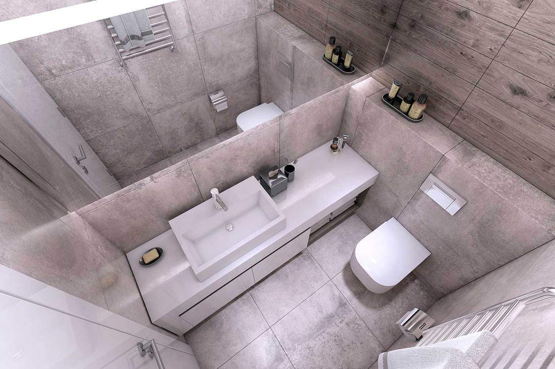 Top view of modern bathroom with concrete walls, toilet seat, sink and wooden paneling wall