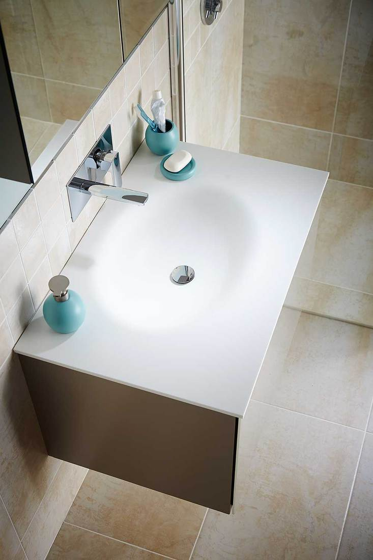Top view of white sink with tap and toiletries in contemporary bathroom