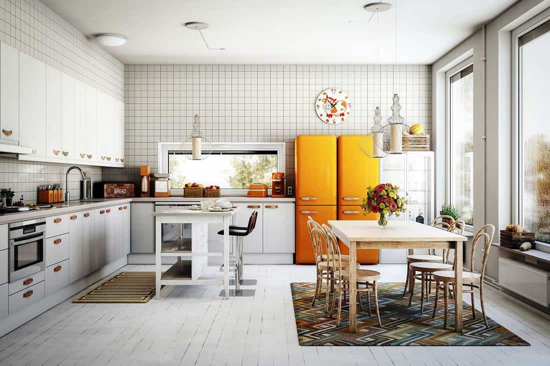 White scandinavian domestic kitchen interior with wooden floor, yellow fridge and large glass windows