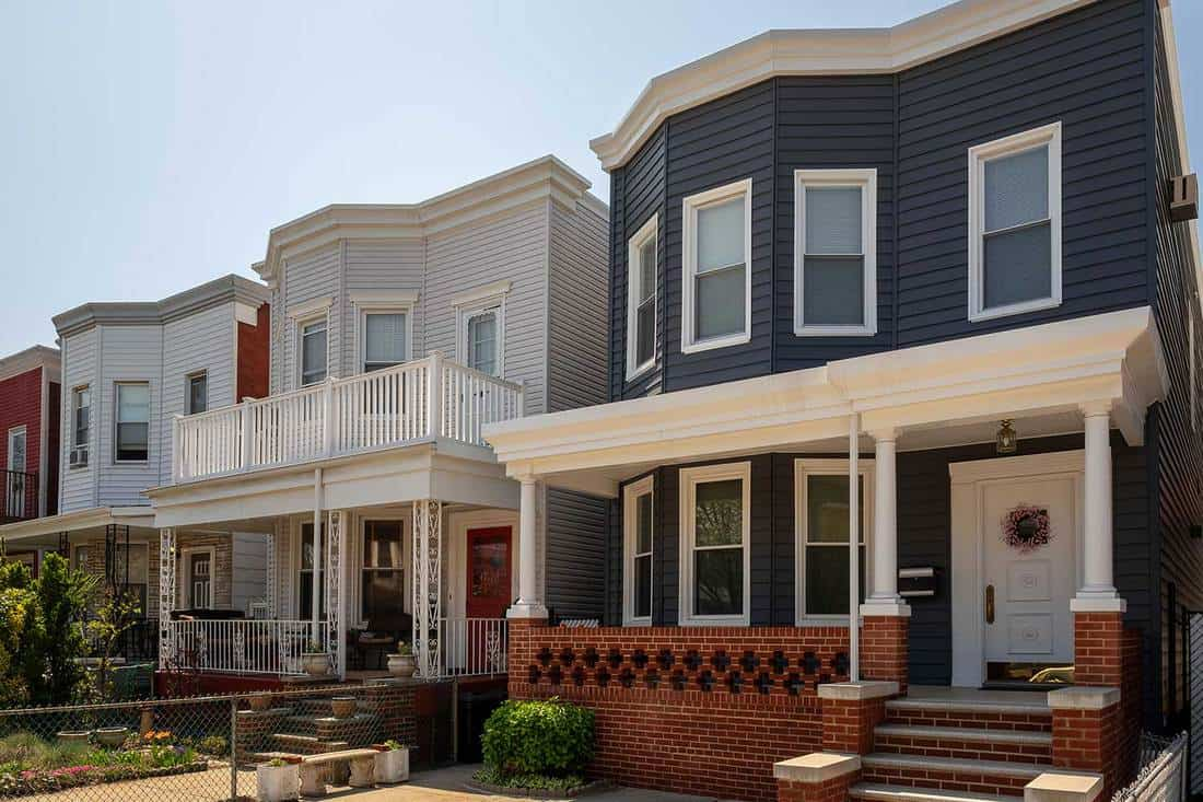 A row of modern houses with front porch