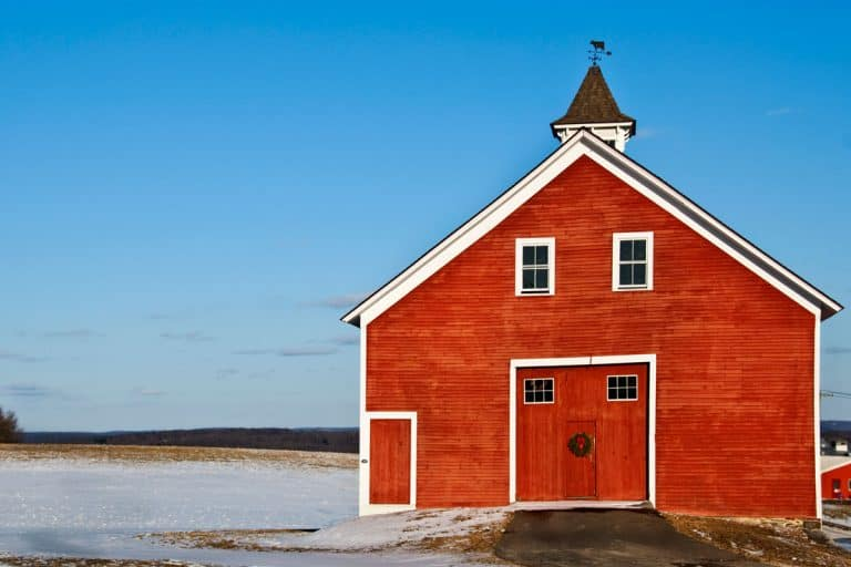 Barn house with red colored door and facade with windows at second floor, 27 Farmhouse Front Door Ideas