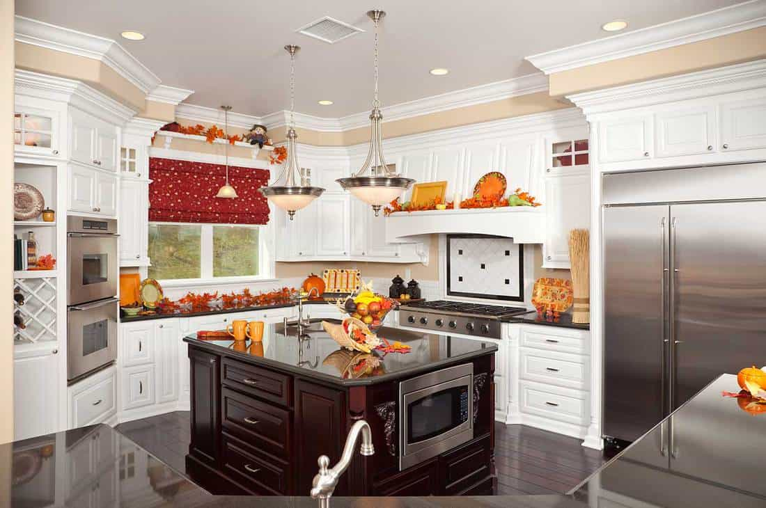 Beautiful custom designer kitchen interior with kitchen island and parquet flooring