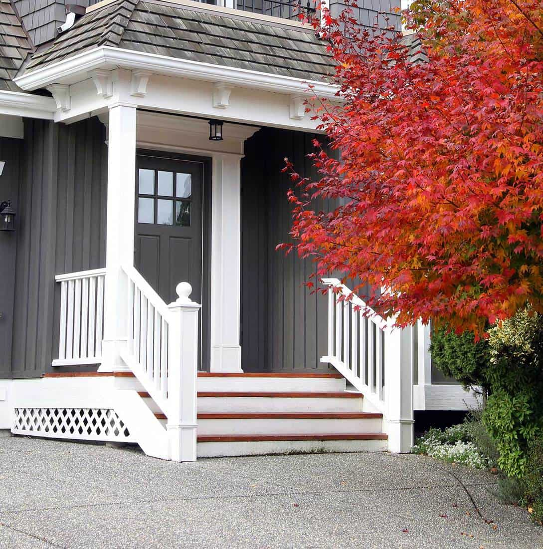 Beautiful upscale grey house in Canada with a Maple tree next to the front door