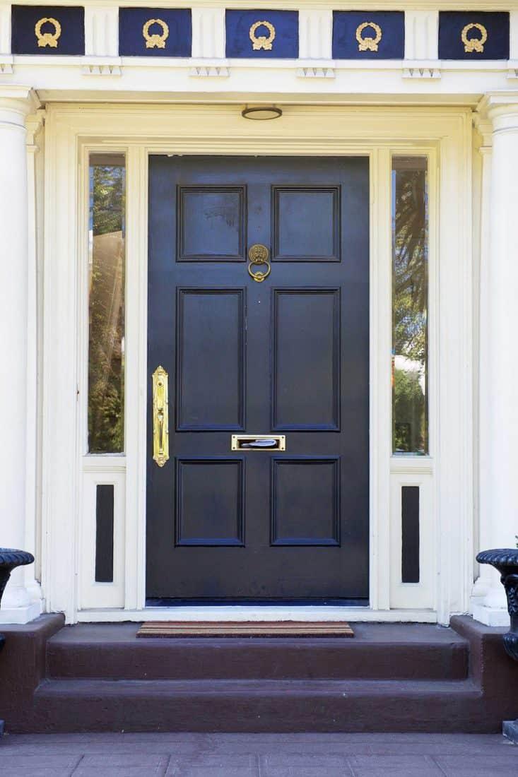 Black door with gold door knob