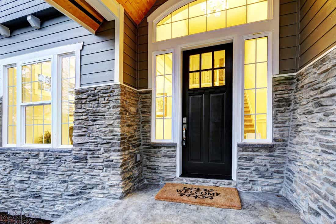 Black door with window and white colored framing