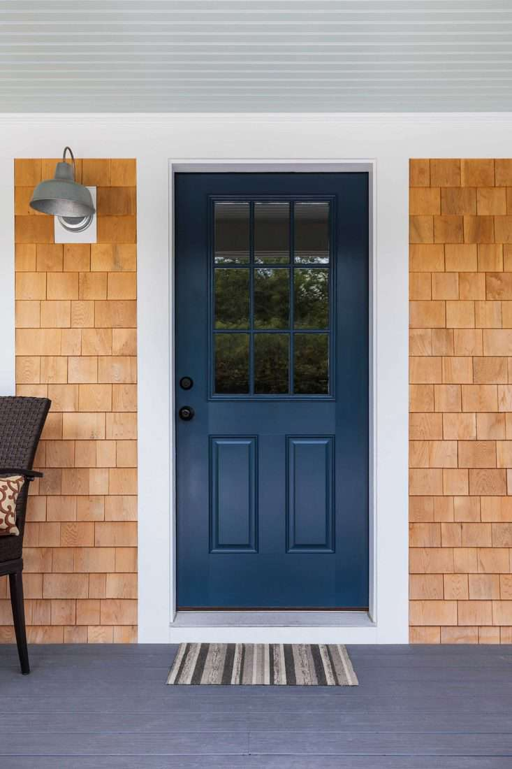 Blue door with window and white colored frame