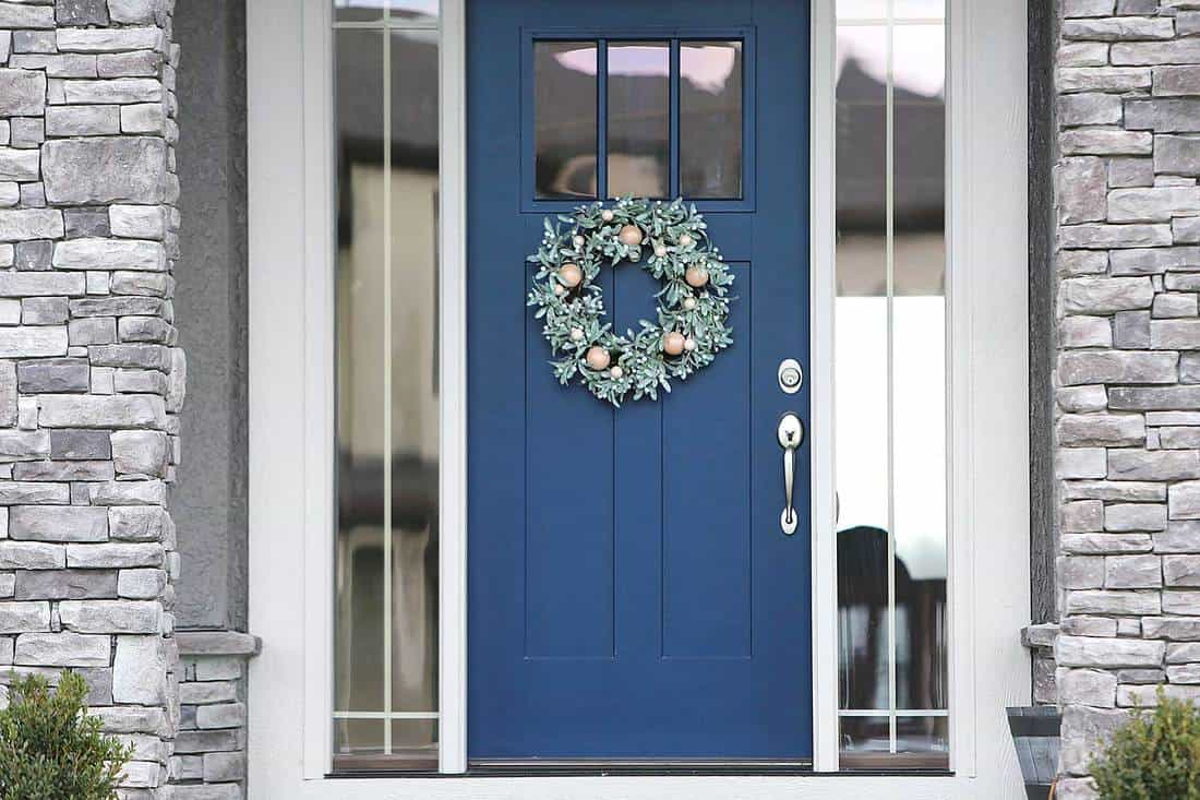 Blue front door with christmas wreath