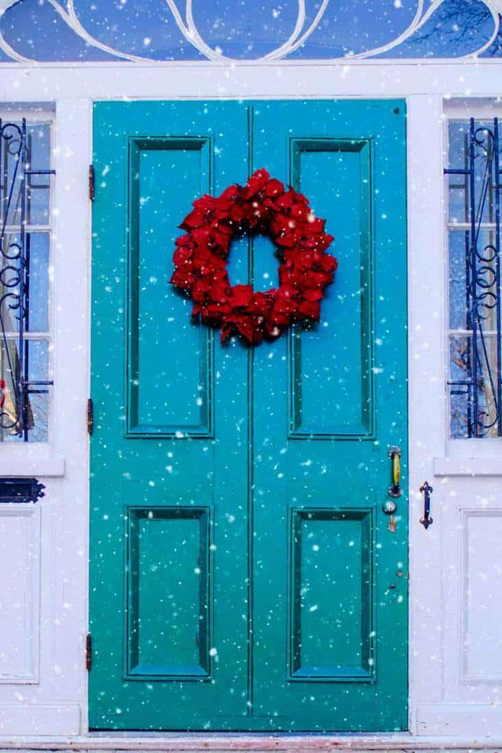 Blue green door with rose christmas wreath for front door decoration