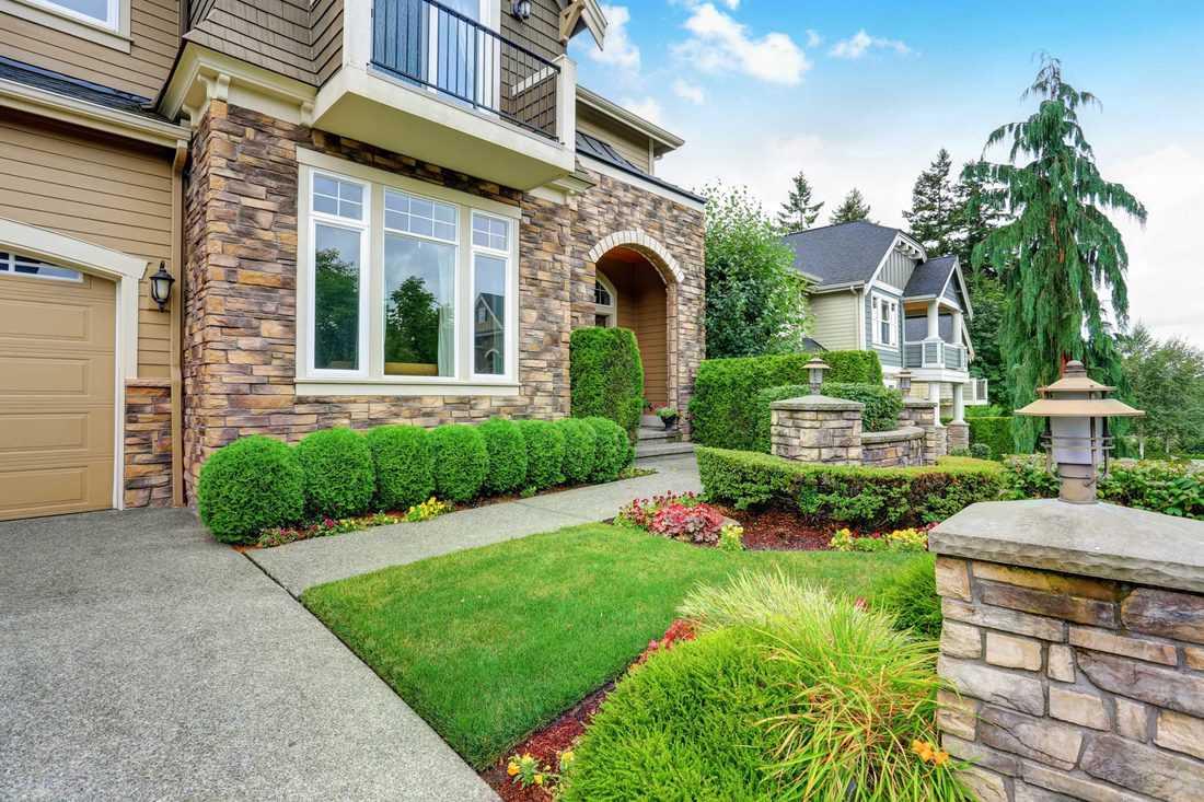 Brick designed facade with green garden