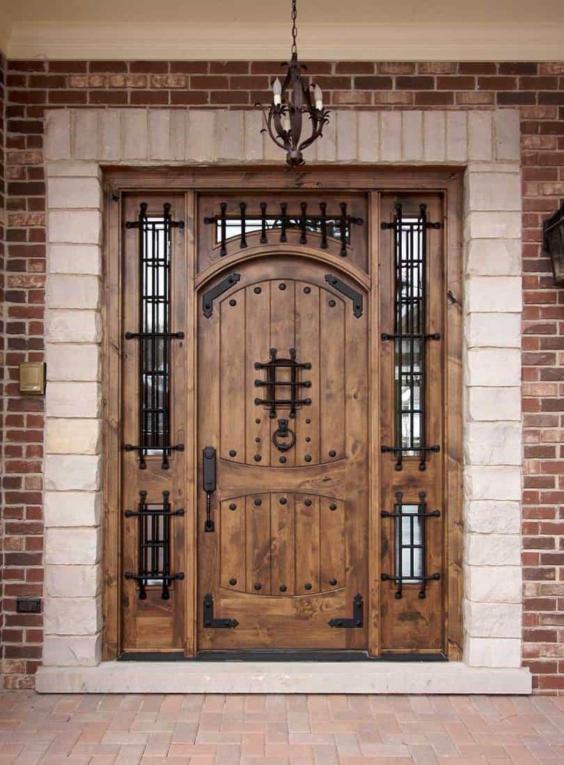 Brick house with patio and hardwood door
