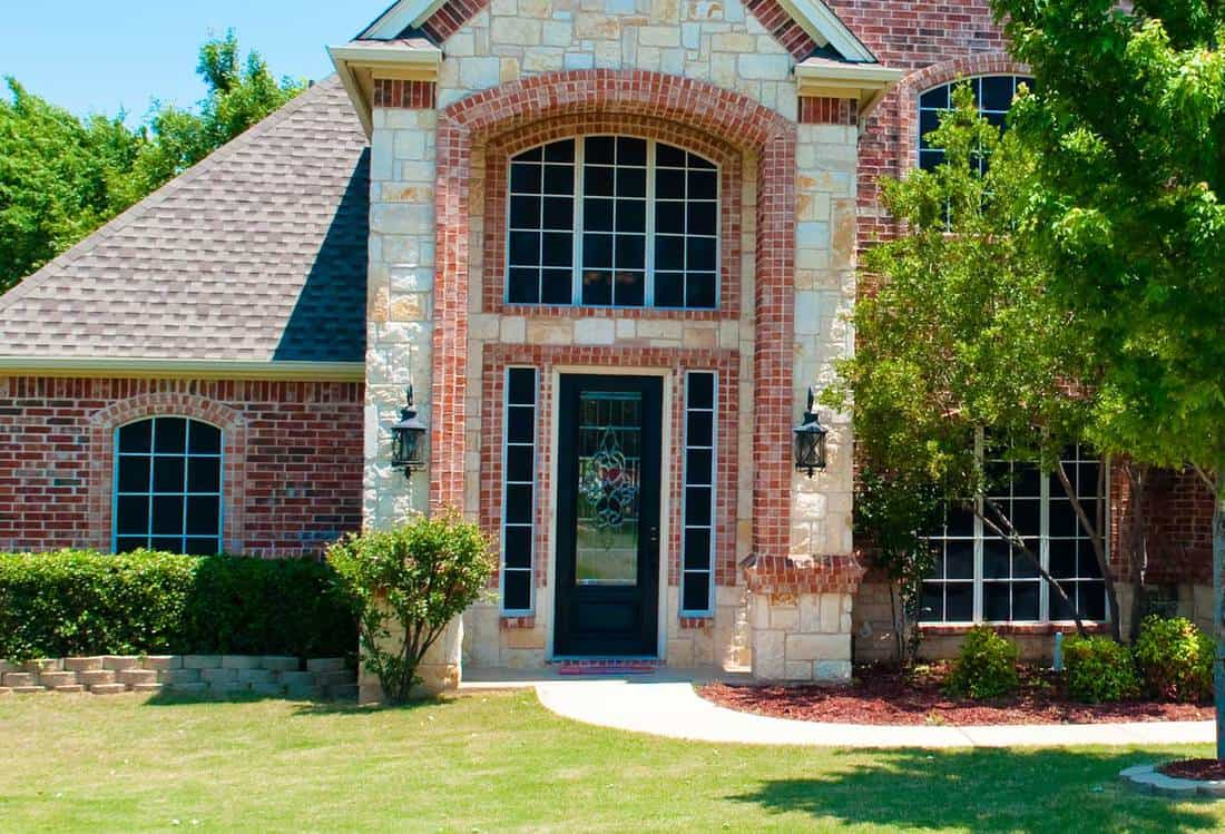Brick residential home with black front door