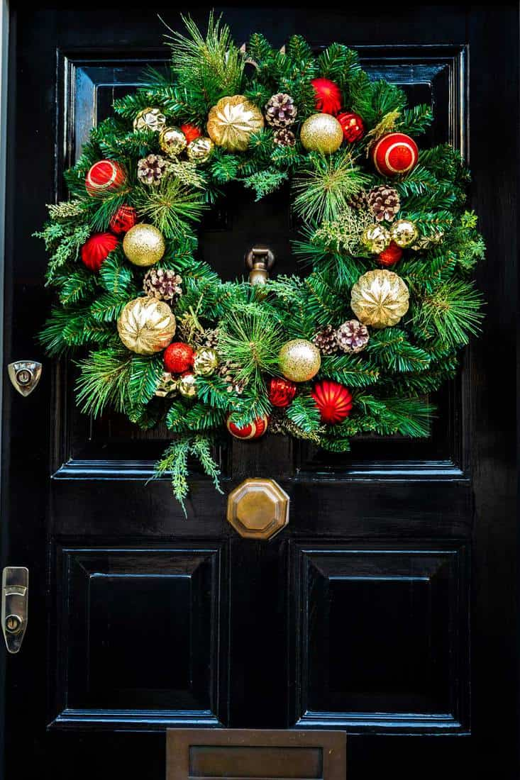 Christmas wreath with christmas ball and plastic pine cone for front door decoration