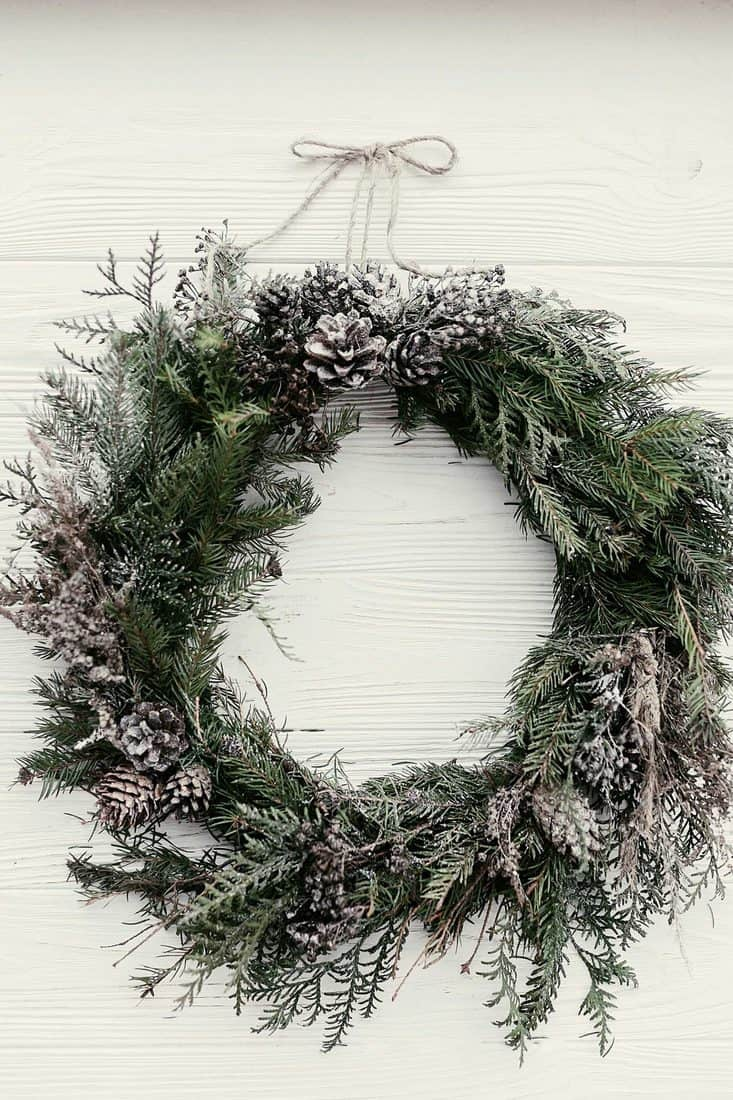 Christmas wreath with pine cone decor item for front door decoration