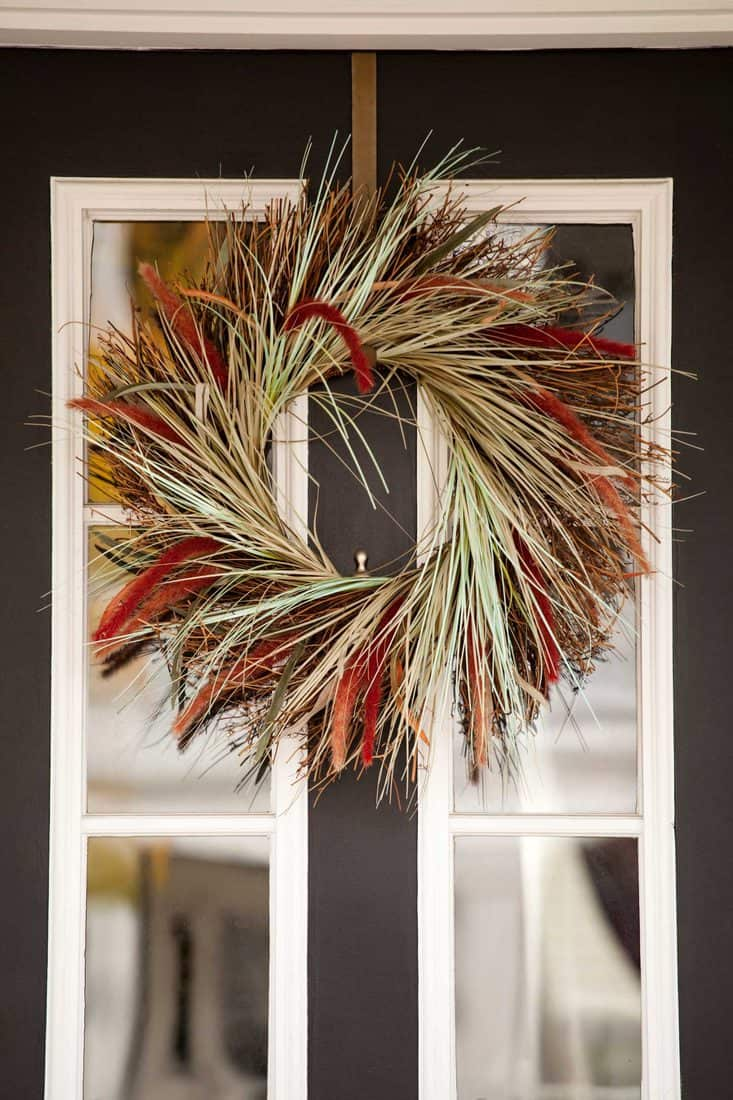 Door with hey designed wreath for fall