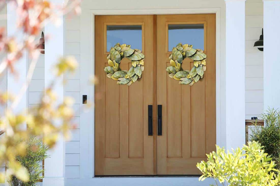 Farmhouse wooden double doors with wreaths