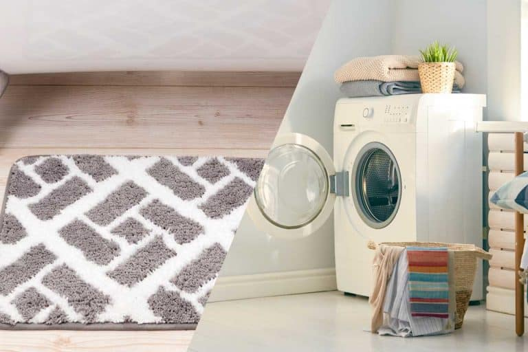 Bathroom mat beside bathtub and a washing machine with open door ready for washing