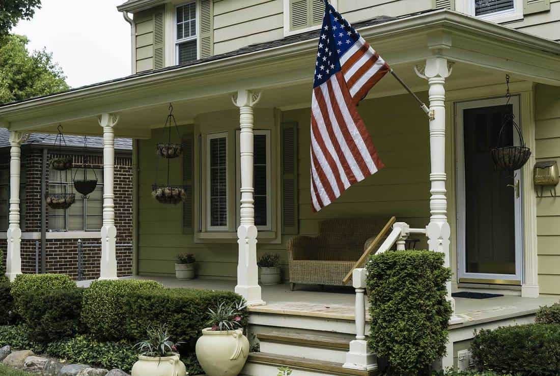 Front porch of a modern domestic house with American flag