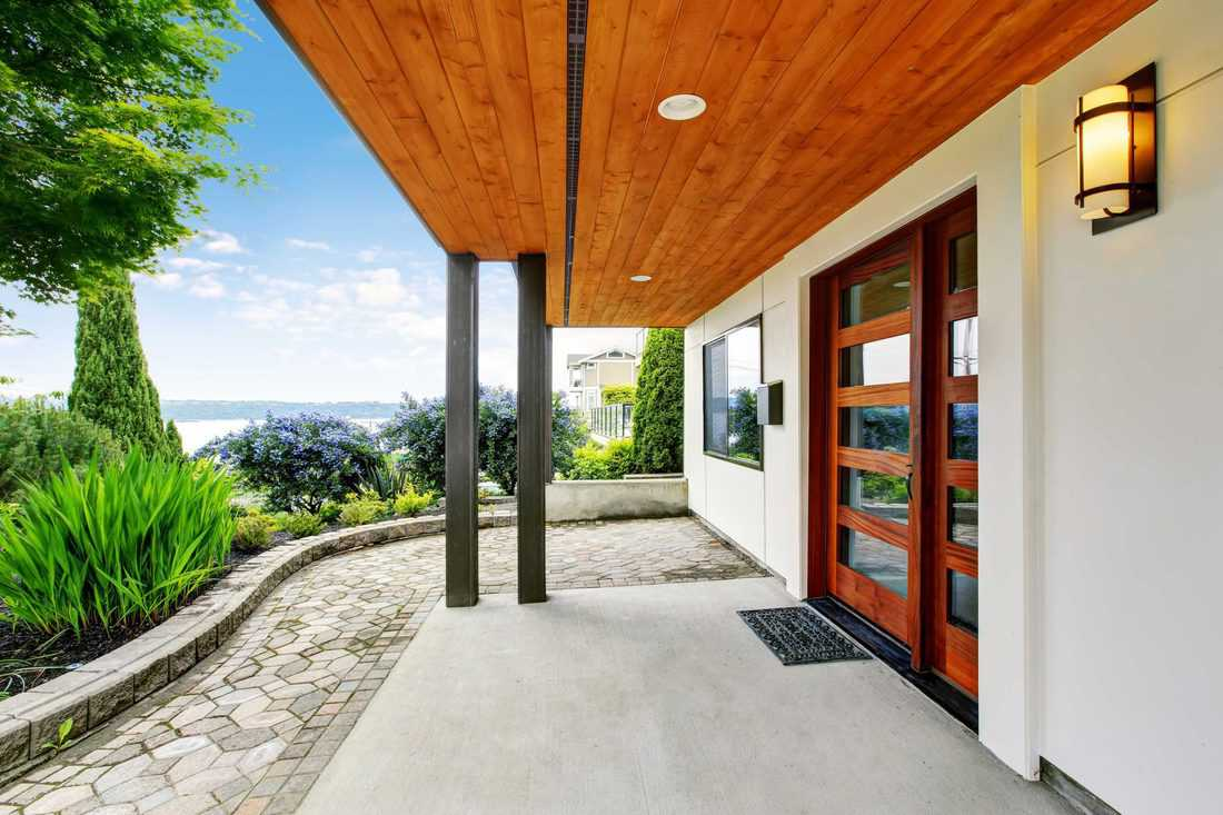 Huge wooden door with horizontal glass with a modern designed porch