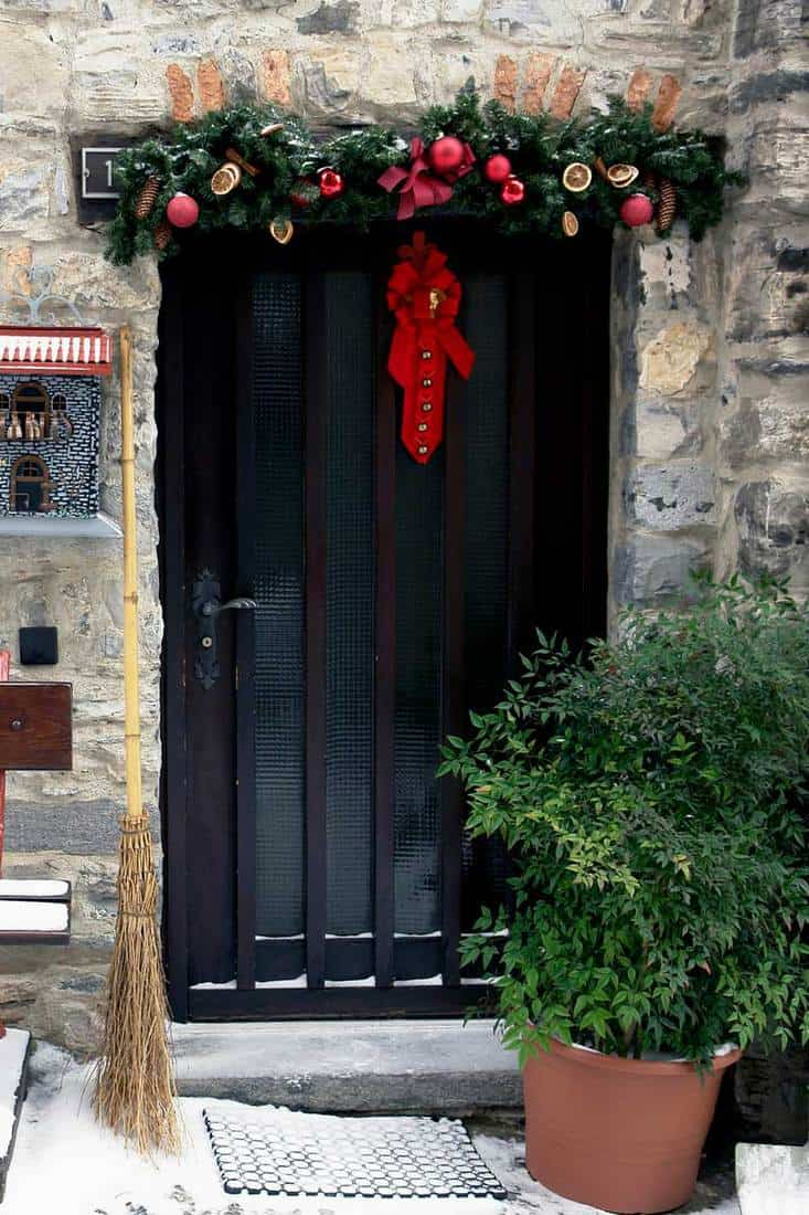 Industrial designed door with red hanging ribbon attached with gold balls