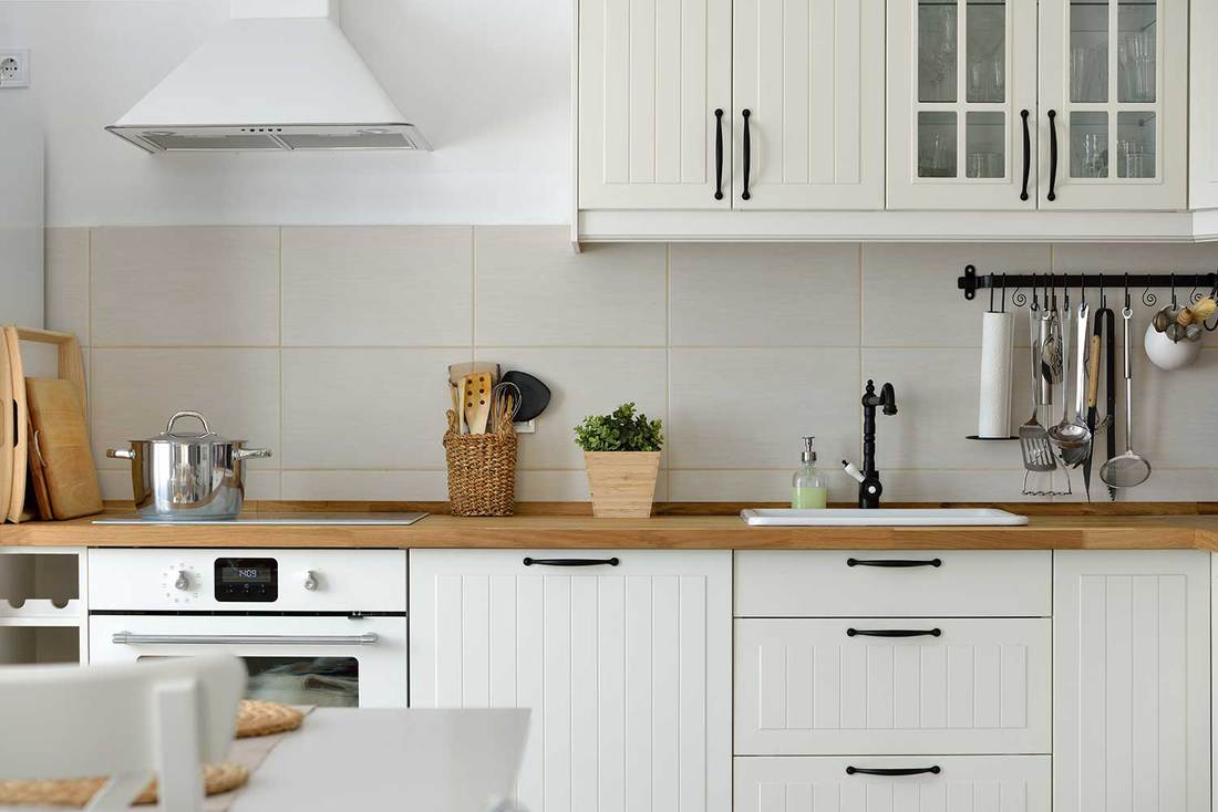 Interior shot from a white Scandinavian style kitchen in an apartment