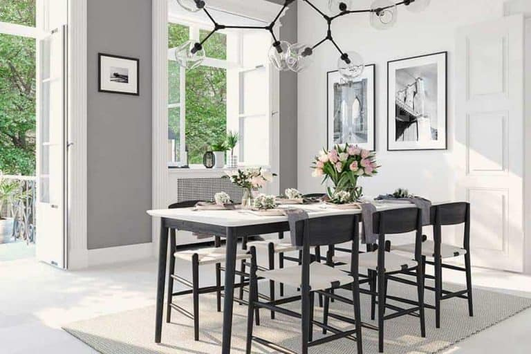 Luxury dining room interior with nordic light chandelier and wall decors