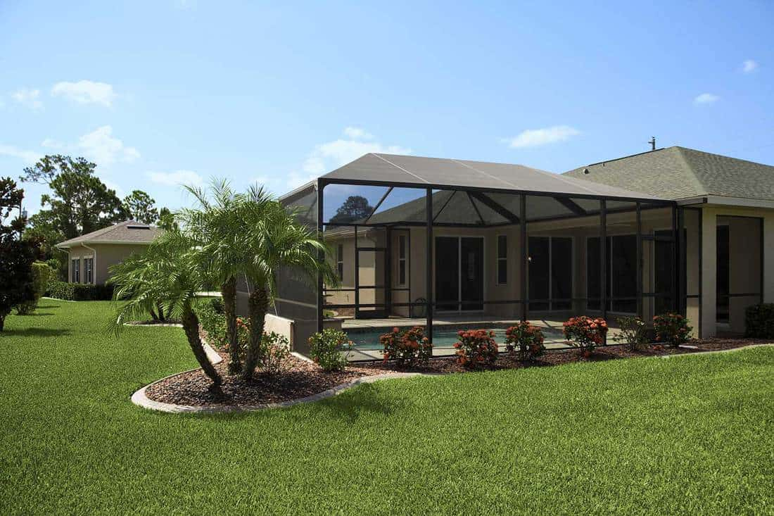 Luxury landscaped tropical villa with screened pool