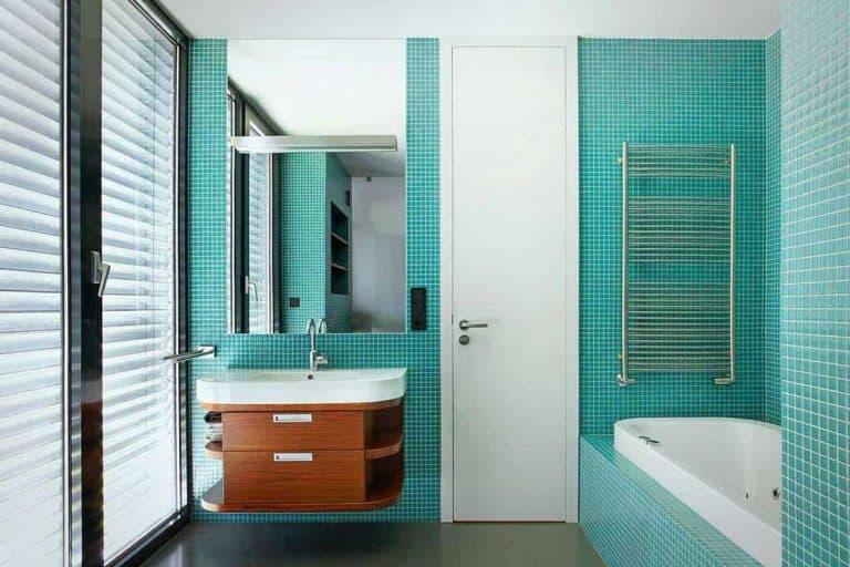 Modern bathroom interior with wash basin mirror and bathtub