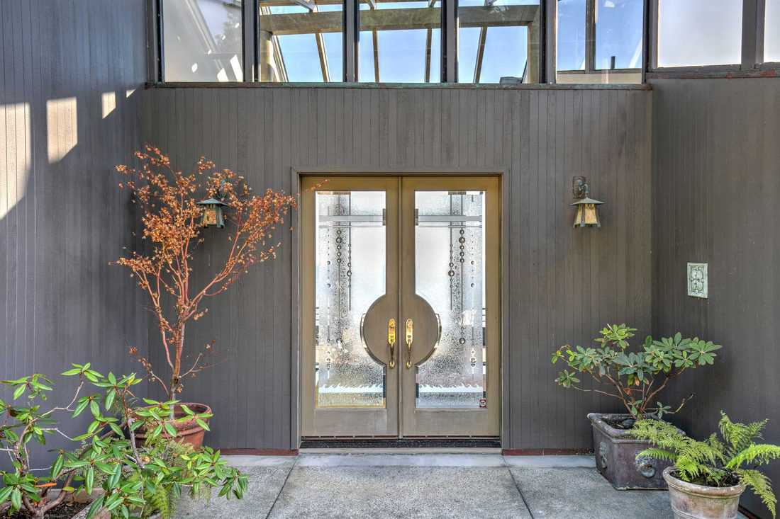 Modern french door with windows and wooden walls with plants for decoration