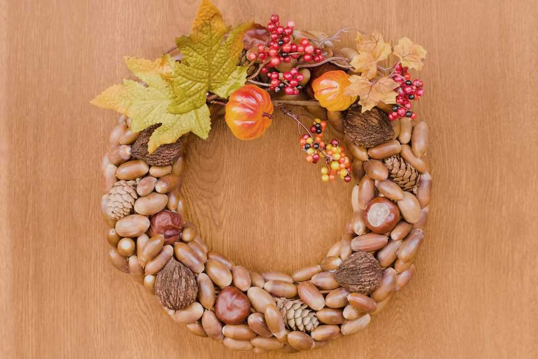 Natural made wreath made with acorns, pine cones, small pumpkins, and leaves