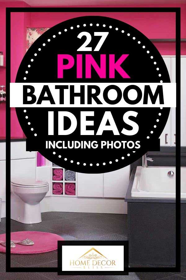 Pink bathroom with tiled floor, bathtub, toilet and towels on cabinets
