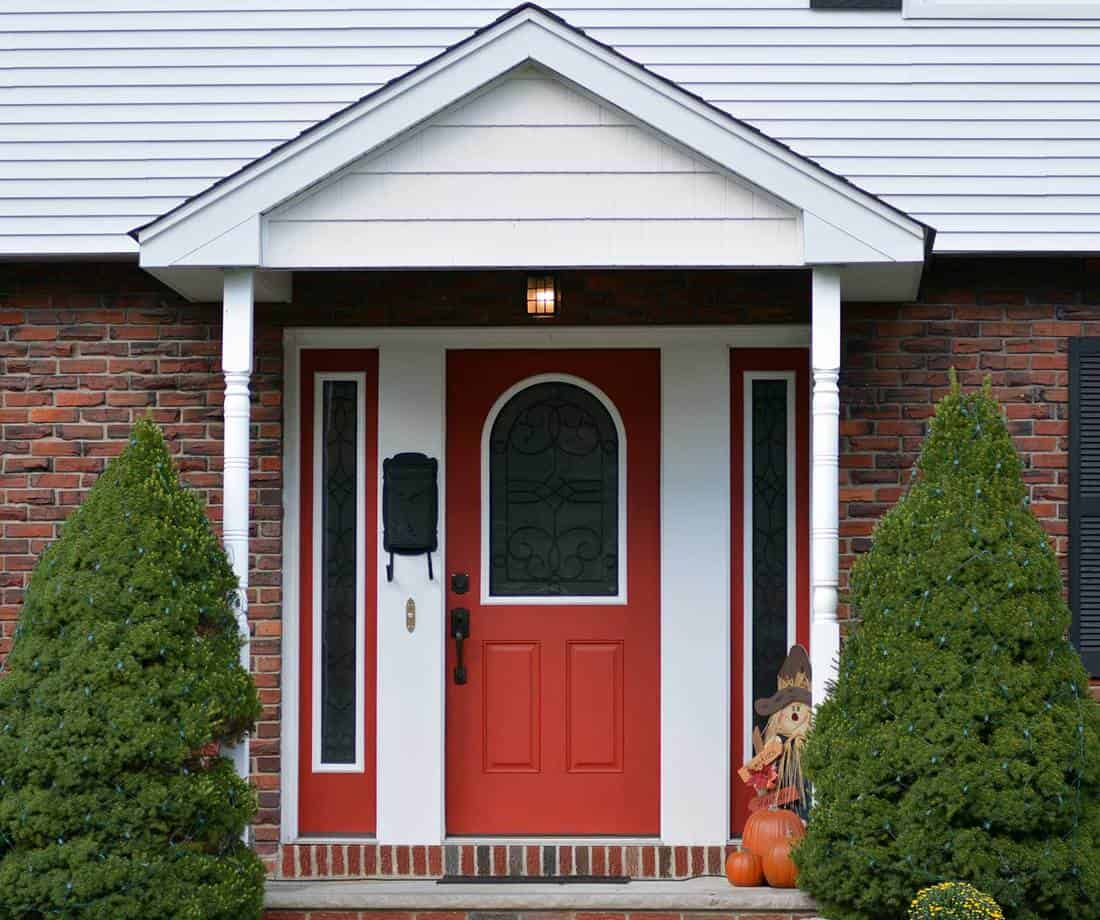 Red front door of brick home