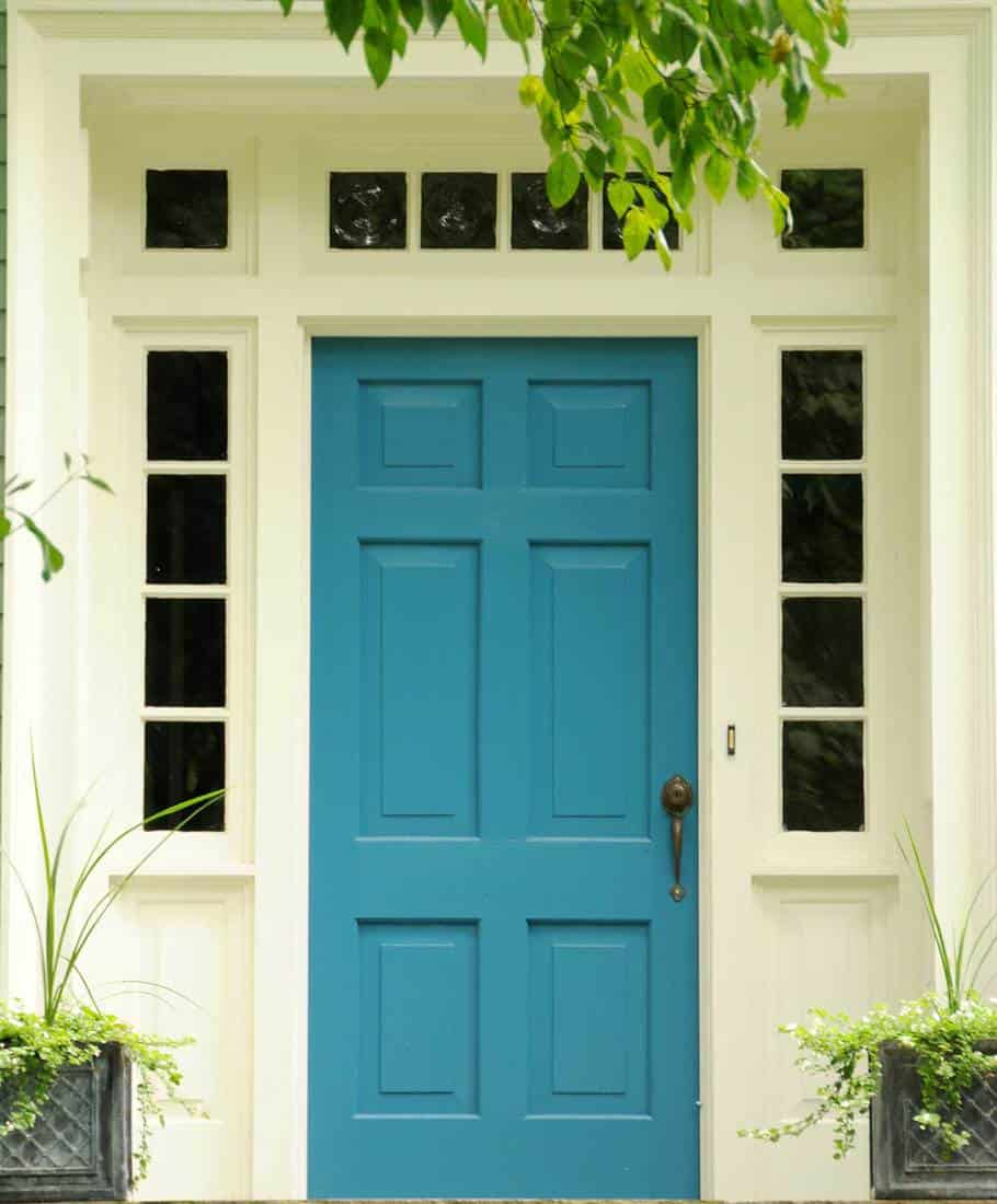 Turquoise front door of traditional home