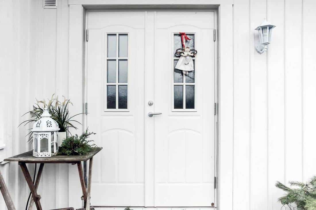 White double door with hanging christmas decoration