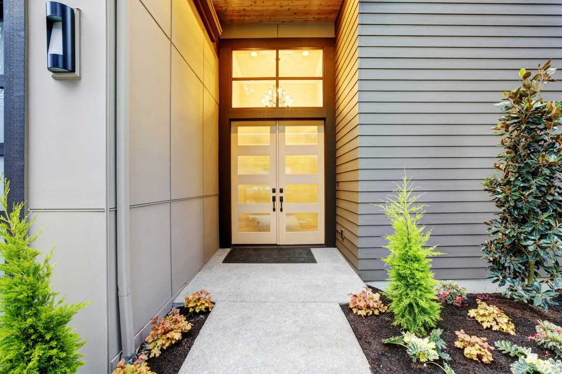 White french door with glass window with grey colored pathway