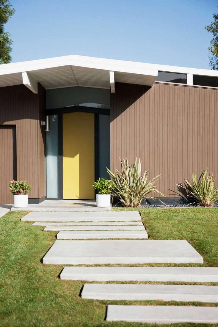Yellow door with glass sidings and rectangular pathways