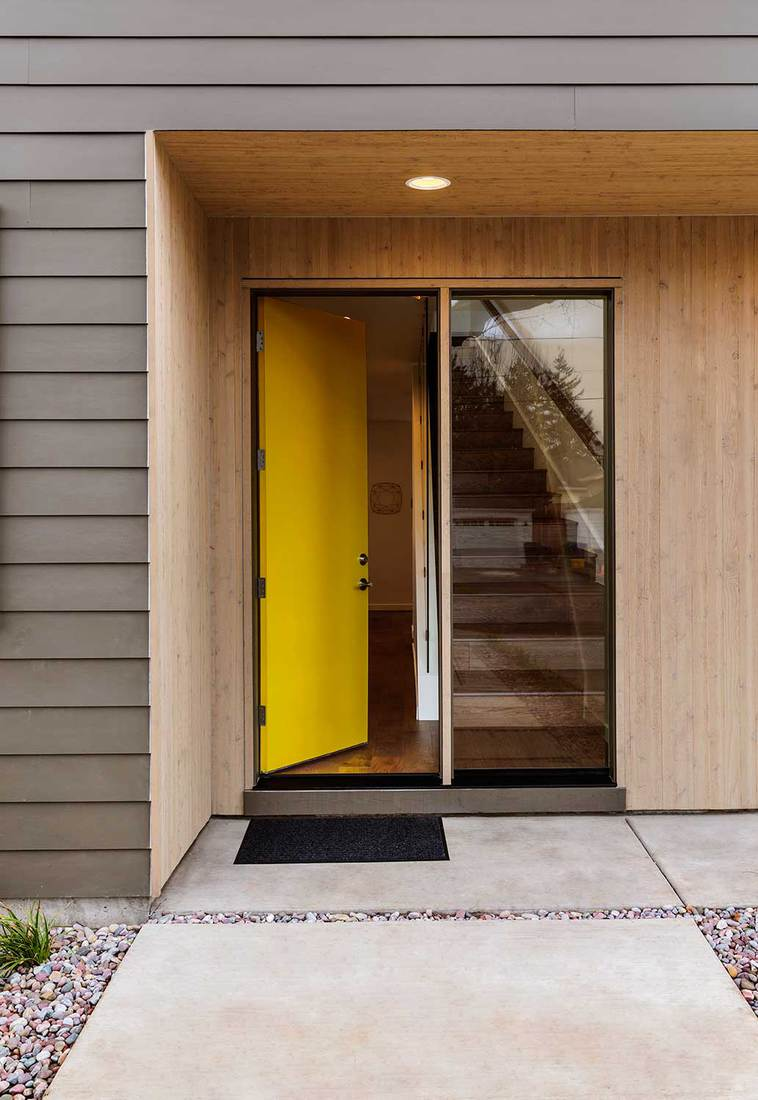 Yellow front door of a modern house